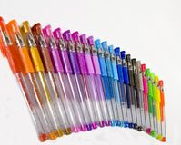 Cascade Of Colored Pens. Colorful pens in a cascade Royalty Free Stock Image