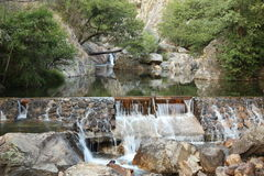 Cascade in a deep valey. A mini cascade in a valley with clean, limpid and fresh water in the interior of Portugal Stock Images