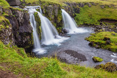 Cascade falls Kirkyyufell Foss on the grassy mountain Stock Photography