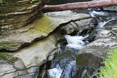 Cascades at Watkins Glen State Park. Cascade falls and naturally curved rock along the river gorge walking trail royalty free stock photo
