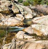 Cascade falls over rocks. Beautifull cascade falls over big rocks on Spanish mountains Royalty Free Stock Photography