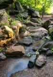 Cascade falls over rocks Stock Photos