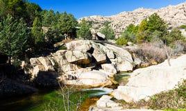 Cascade falls over rocks, landscape. Cascade falls over big rocks on Spanish mountains, landscape Royalty Free Stock Image