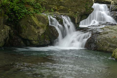 Cascade falls with rocks Stock Photo