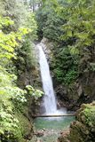 Cascade Falls. This stunning 30 meter waterfall is located NE of Mission BC in Cascade Falls Regional Park. A sturdy suspension bridge, a recent addition to the Royalty Free Stock Images