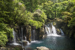 Cascade flowing Stock Images