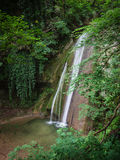 Cascade in the forest. Royalty Free Stock Photography