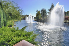 Cascade of fountains on the lake in the park. Amazingly beautiful place in the landscape park near Kiev Royalty Free Stock Photos