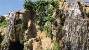 Cascade of the Genoves Park, Cadiz. Video recorded in slow motion of the waterfall in the park stock video