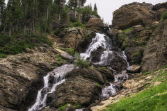 Cascade in Glacier National Park. Royalty Free Stock Photo