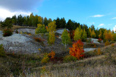 Cascade of limestone hills covered with trees with autumn foliage Royalty Free Stock Photography