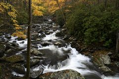 Cascade in Little Pigeon River in the Autumn. Large cascade in Litttle Pigeon River at Great Smoky Mountains National Park, TN USA royalty free stock image