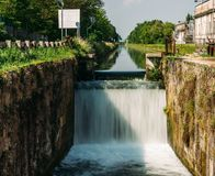 Cascade on a lock at the Naviglio Pavese, a canal that connects the city of Milan with Pavia, Italy,. Cascade on a lock at the Naviglio Pavese, a canal that stock photos