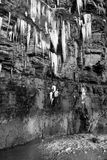 Cascade of melting icicles on a cliff face Royalty Free Stock Image