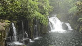 Cascade in mist stock footage