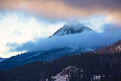 Cascade Mountain Range Over Lake Keechelus. View of a snowy peak in the Cascade mountain range to the west over Lake Keechelus, near Snoqualmie Pass. Photo taken Stock Photography