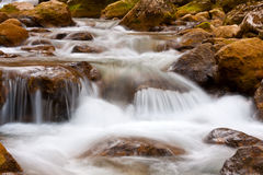 Cascade of mountain river Stock Photos