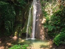 Cascade in the forest. Royalty Free Stock Photo