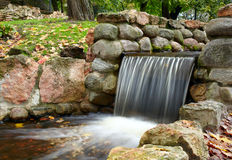Cascade in the park. Stock Photos