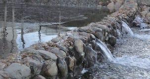Cascade pond in the park. In the urban landscape park Yuzhnoye Butovo, the freezing cascade pond stock video