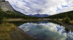 Cascade Ponds Reflections. Reflective and picturesque Cascade Ponds just outside of Banff, in Banff National Park, Canadian Rockies, Alberta, Canada Stock Photos