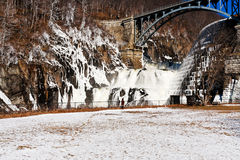 Cascade on river dam in winter Royalty Free Stock Image