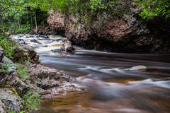 Cascade River with Fallen Log. This is a stream at Cascade River State Park in Minnesota Stock Photography