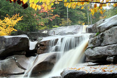 Cascade river flow with fall foliage. A river cascade and flow with fall foliage in New Hampshire's White Mountains Royalty Free Stock Photos