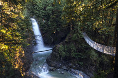Cascade Suspended. A suspension bridge hangs over the chasm leading towards Cascade Falls, Mission, BC, Canada Stock Photo