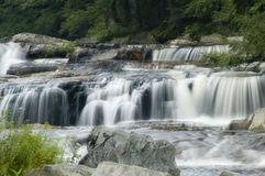 Cascade too. A series of small waterfalls side by side Royalty Free Stock Photography