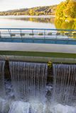 Cascade on urban lake. Scenery with urban lake and water falling Royalty Free Stock Photos