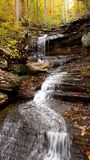 Cascade water flow in autumn royalty free stock photo