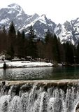 Cascade of water in the Lake with the mountains. Big cascade of water in the Lake with the mountains Royalty Free Stock Image