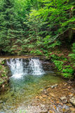 Cascade Water in the mountain forests Stock Image