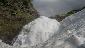Cascade waterfall falling in snowball stock video