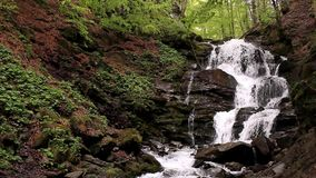 Cascade waterfall in mountains. Water falling landscape. Cascade waterfall in mountains at spring. Mountain river falling into waterfall. Water landscape in stock video footage