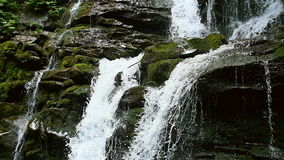 Cascade waterfall splash on stones in forest among mountains. Slow motion. stock video footage