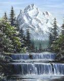 Cascades à écriture ligne par ligne de montagne Photographie stock