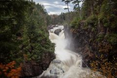 Magic waterfall scene. The cascades of running water Stock Photos