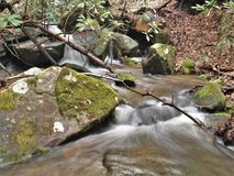 Cascades on Stone Mountain Creek in North Carolina. Water cascades over rocks creating small falls along Stone Mountain Creek in Stone Mountain State Park.  Low Stock Images