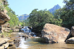 Cascades waterfall in Royal Natal national park, South Africa. Royal natal national park in South Africa. Amphitheater mountain visible in distance. Cascades stock photo