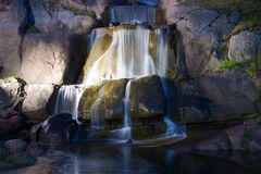 Cascades waterfall in Sapokka water garden the June night. Kotka, Finland Royalty Free Stock Photography