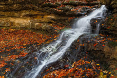 Cascading Autumn Waterfall Stock Image