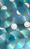 Cascading CDs. A pile of rewritable CDs stock images