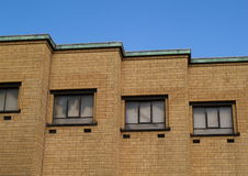 Cascading facade of yellow brick building Royalty Free Stock Images