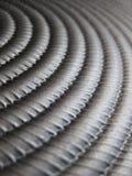 Cascading ridged metal texture. Ridged metal teeth texture cascading down Royalty Free Stock Images