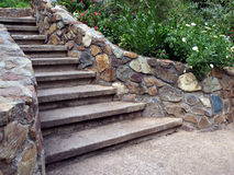 Cascading stone staircase with lush foliage Royalty Free Stock Photography
