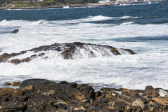 Cascading water. Ocean water cascading over the rocks the coast of new England Royalty Free Stock Photo