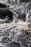 Cascading. Water cascading over rocks at an small stream Stock Image