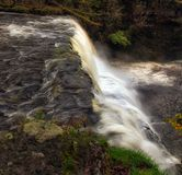 Cascading water at Sgwd Clun Gwyn waterfall Royalty Free Stock Photography